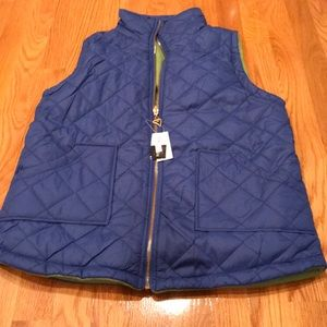 New with tags reversible vest